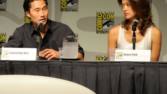 "SAN DIEGO - JULY 23:  Actors Daniel Dae Kim and Grace Park speak during the ""Hawaii Five-0"" panel discussion during Comic-Con 2010 at San Diego Convention Center on July 23, 2010 in San Diego, California.  (Photo by Frazer Harrison/Getty Images)"