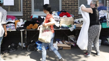 Clothes are offered to those affected by the fire that ripped through Grenfell Tower, a residential block in west London on June 14.