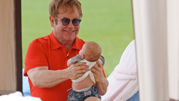 John holds his son Zachary Jackson Levon in 2011. John and his longtime partner, David Furnish, had the baby through a surrogate. They later welcomed a second son to their family, Elijah Joseph Daniel.