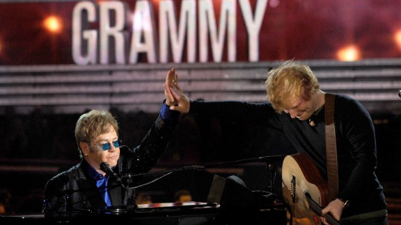 """John performs with Ed Sheeran at the 2013 Grammy Awards. They teamed up for Sheeran's song """"The A Team."""""""
