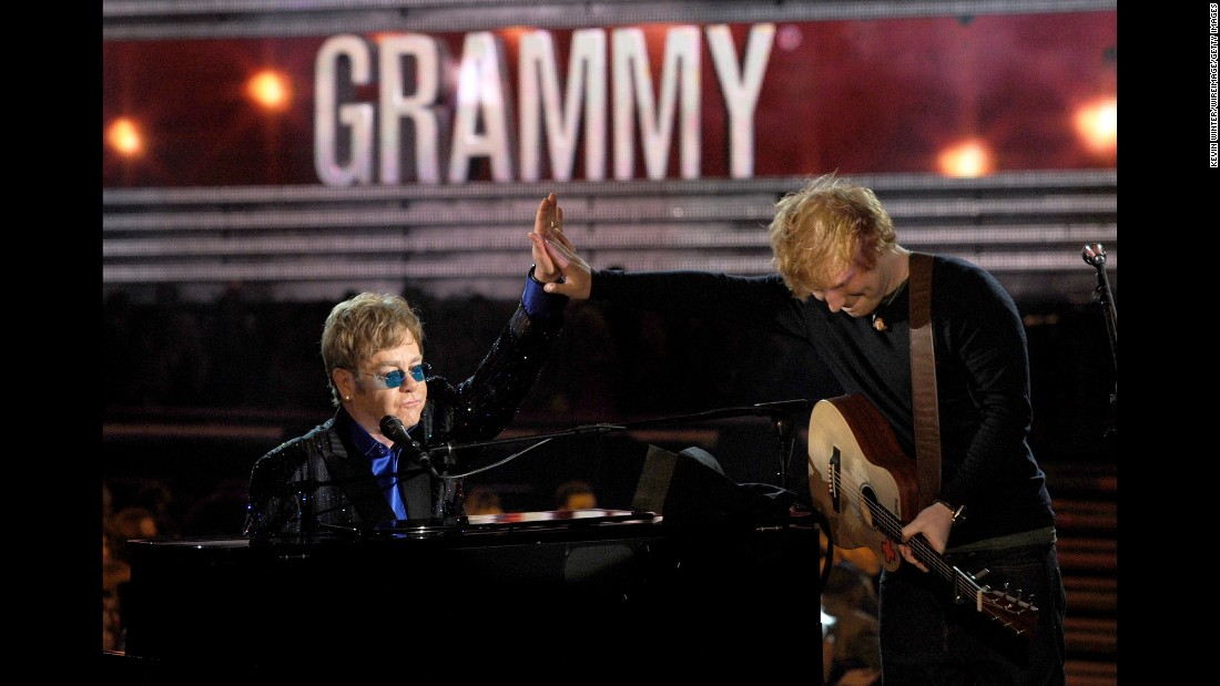 "John performs with Ed Sheeran at the 2013 Grammy Awards. They teamed up for Sheeran's song ""The A Team."""