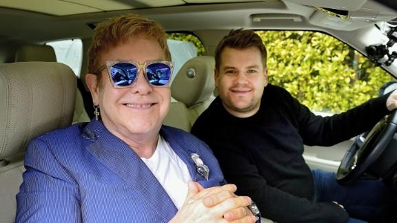 """John joins talk-show host James Corden for a a little """"carpool karaoke"""" in 2016."""
