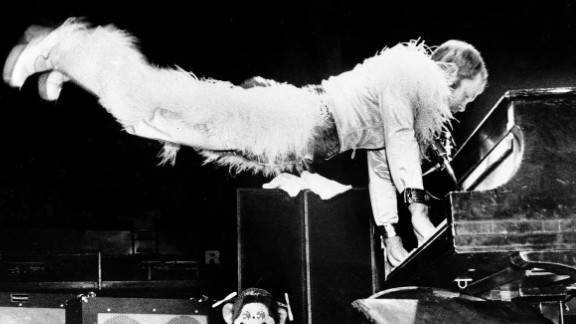 """John gives a typical energetic performance in 1974. Some of the other hit songs he had by this time: """"Tiny Dancer,"""" """"Levon,"""" """"Crocodile Rock"""" and """"Rocket Man."""""""