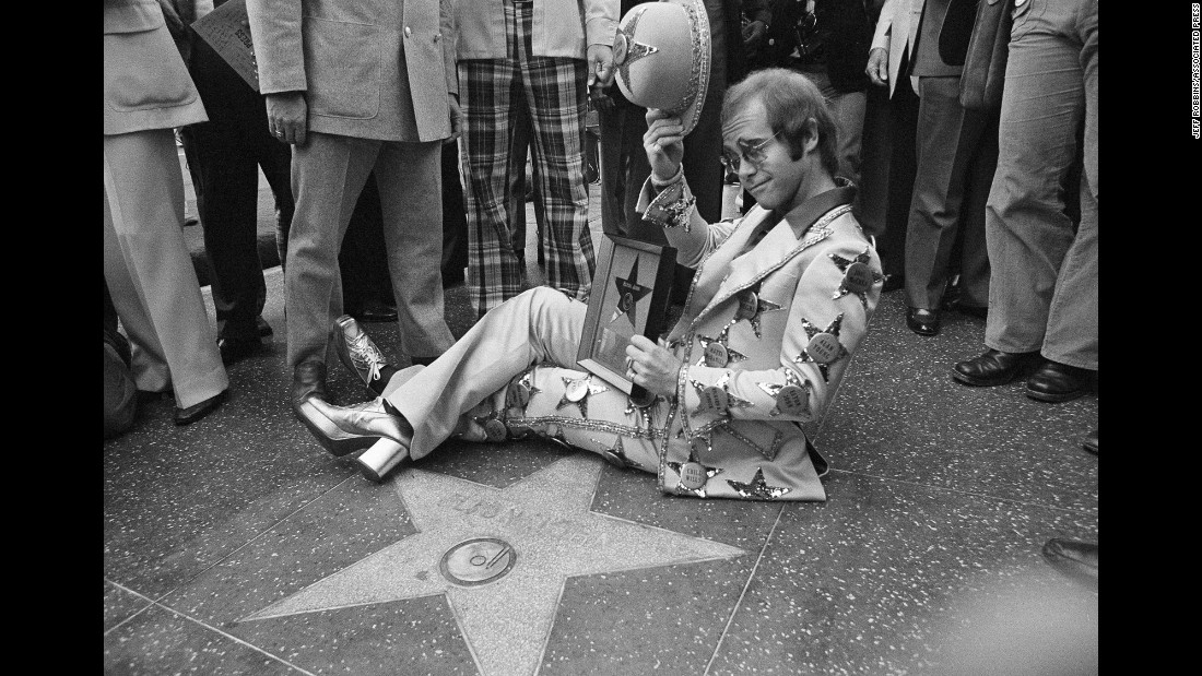 John tips his hat after having a star dedicated to him on the Hollywood Walk of Fame in 1975.