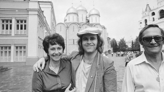 John poses with his mother and stepfather while touring the Kremlin in Moscow in 1979. He was the first rock or pop star from the West to perform in the Soviet Union.