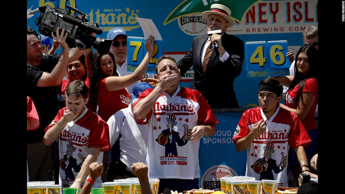 Competitive eaters take part in Nathan's Hot Dog Eating Contest in New York. Joey Chestnut, center, won the annual competition for the 10th time in 11 years. He ate a record 72 hot dogs in 10 minutes.