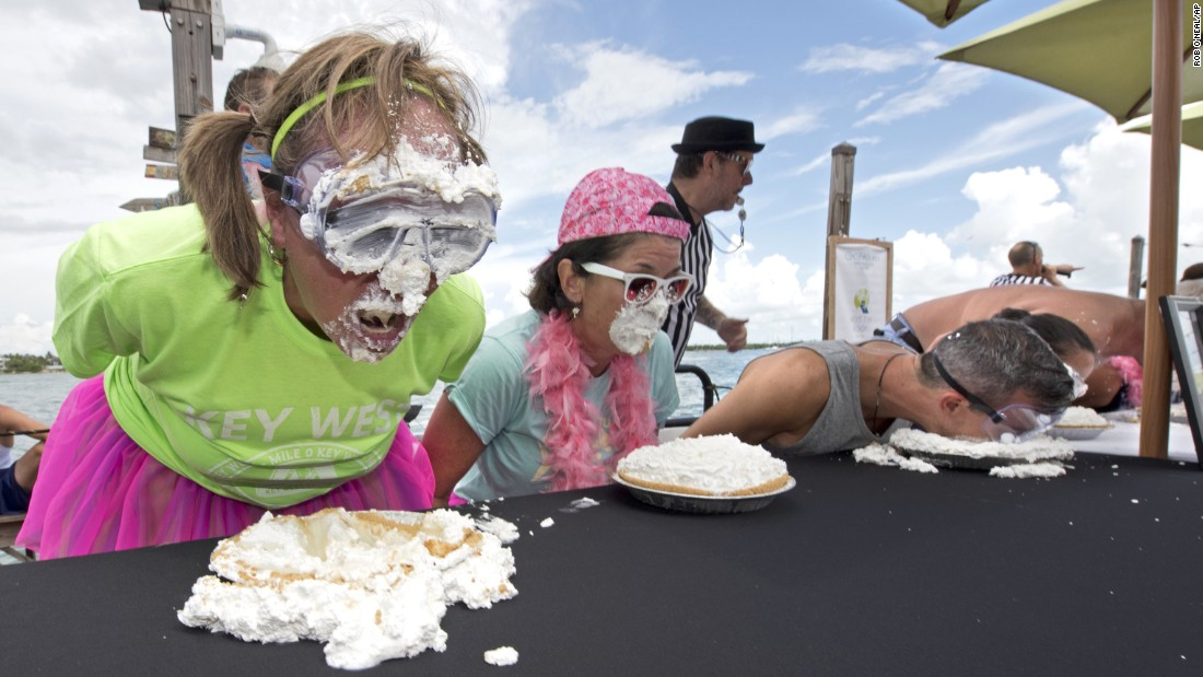 Deb Settle, left, comes up for air while competing in the Mile-High Key Lime Pie Eatin' Contest in Key West, Florida. The competition was staged as the Florida Keys' answer to New York's hot dog eating contest.