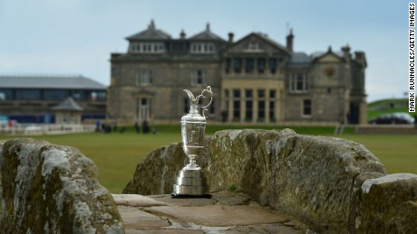 ST ANDREWS, SCOTLAND - The Claret Jug sits by the Swilcan Bridge on the 18th fairway in front of the famous St Andrews club house building, during the Open Championship Media Day at Fairmont St Andrews on April 20, 2015, in St Andrews, Scotland. (Photo by Mark Runnacles/Getty Images)