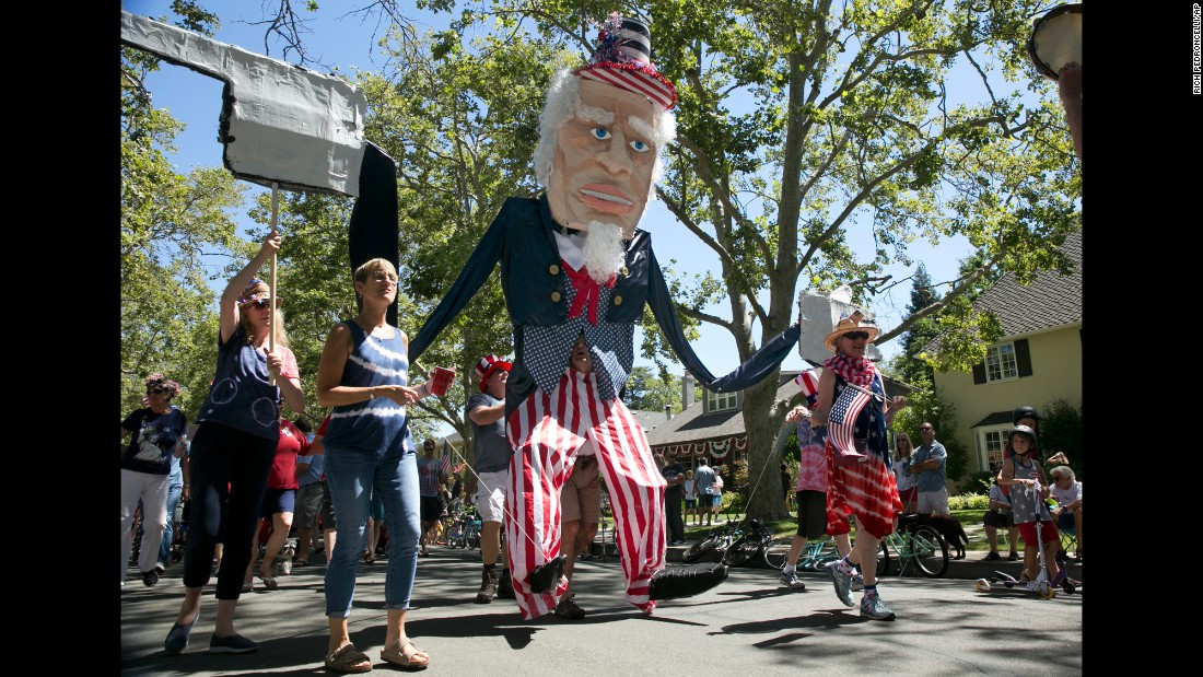 A 15-foot-tall Uncle Sam marches in a parade in Sacramento, California.