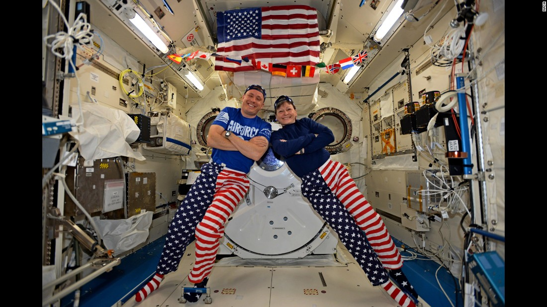 "NASA astronauts Jack Fischer and Peggy Whitson celebrate the Fourth of July from the International Space Station. Fischer shared this photo on social media and said, ""We sometimes have issues standing up straight, but we have no problems at all showing our American pride-Happy 4th!"""