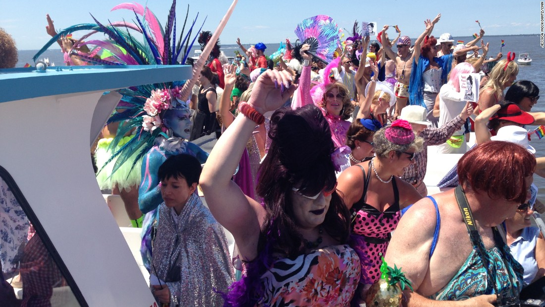 "Drag queens party on the top of a boat during ""The Invasion of the Pines"" on Tuesday, July 4. The event has taken place in Fire Island Pines, New York, on every Fourth of July since 1976."