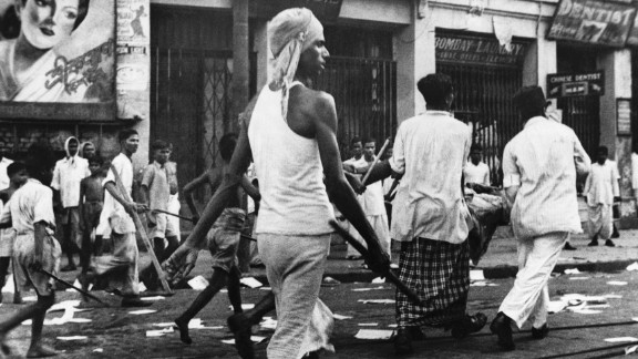 Armed rioters walk through the streets of Calcutta, now known as Kolkata, in August, 1946.    Communal violence between Hindus and Muslims broke out during Direct Action Day, called by the Muslim League as a day of strikes, although it was open to different interpretations. The violence lasted for days and it is estimated that at least 4,000 died in Kolkata.