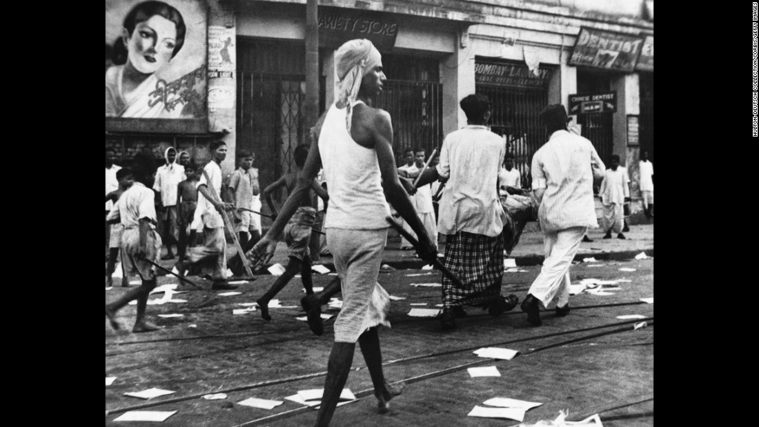 "Armed rioters walk through the streets of Calcutta, now known as Kolkata, in August, 1946.  <br /><br />Communal violence between Hindus and Muslims broke out during Direct Action Day, called by the Muslim League as a day of strikes, although it was open to different interpretations. The violence lasted for days and it is estimated that at least <a href=""https://books.google.co.uk/books?redir_esc=y&id=i9WdQp2pwOYC&q=direct+action+day#v=snippet&q=direct%20action%20day&f=false"" target=""_blank"">4,000 died</a> in Kolkata."