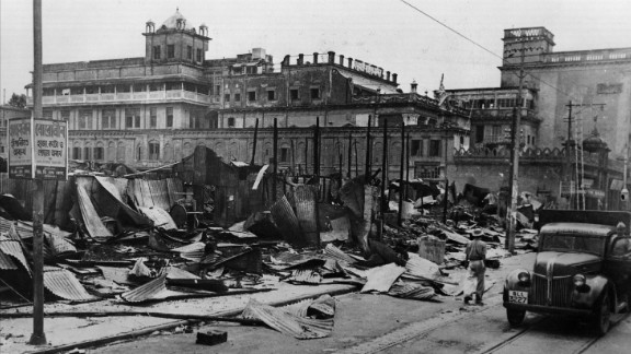 Burnt-out shops line a street after the Hindu-Muslim rioting in Kolkata on August 28, 1946.