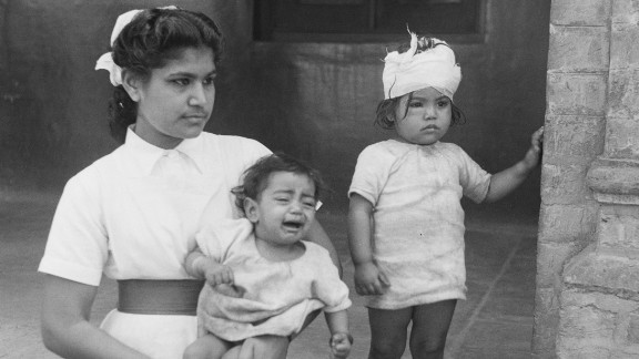 A nurse with two children who were rescued and taken to a hospital during communal unrest in Amritsar, Punjab, north India, in March 1947.