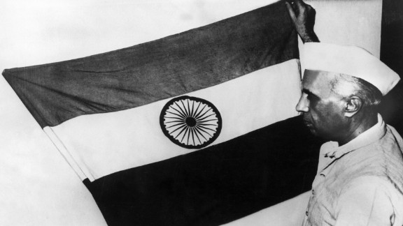 Nehru, then-vice president of the Indian National Congress party, presents the national flag of the nation during a meeting of the constituent assembly in July 1947.