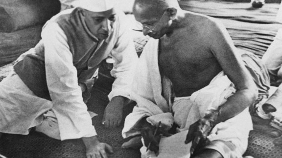 Jawaharlal Nehru (left) and Mahatma Gandhi (right) deep in conversation in Bombay, now Mumbai, India, in August 1942.  India had been under the rule of the British since 1858, but had been agitating for self-governance for years. The country finally gained independence in August 1947. Nehru was a prominent Indian politician who became independent India