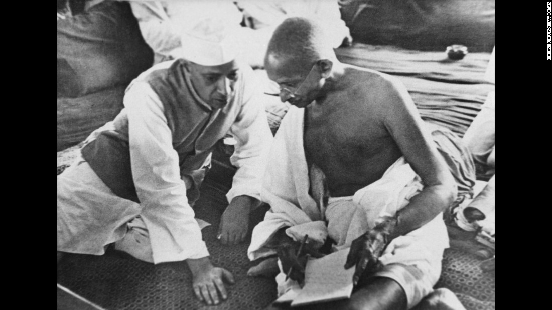 Jawaharlal Nehru (left) and Mahatma Gandhi (right) deep in conversation in Bombay, now Mumbai, India, in August 1942.<br /><br />India had been under the rule of the British since 1858, but had been agitating for self-governance for years. The country finally gained independence in August 1947. Nehru was a prominent Indian politician who became independent India's first prime minister. Nehru was a close friend of Gandhi, whose non-violent movement was fundamental to India's attainment of independence.