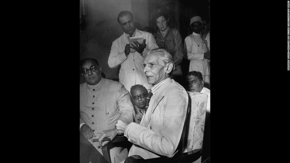 Leader of the Muslim League, Muhammad Ali Jinnah (center), holds a press conference in Mumbai, India, in July 1946. <br /><br />The Muslim League formed in 1906 to look after the interests of India's minority Muslim community. Jinnah demanded the creation of a separate Muslim nation called Pakistan by the time Britain handed over its power.