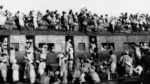 Hundreds of Muslim refugees crowd on top of a train leaving New Delhi for Pakistan in September 1947.   Partition led to millions being forced to migrate across the subcontinent. It