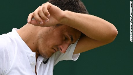 "Bernard Tomic crashed out of Wimbledon on Tuesday saying afterwards that he was ""bored"" of tennis."