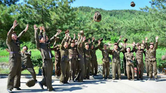 North Korean soldiers celebrate the launch of the Hwasong-14, the country