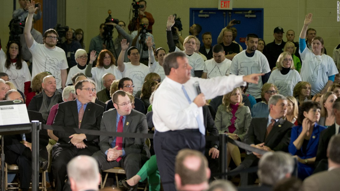 "Demonstrators stand with the word ""Bridgegate"" spelled out on their shirts during a town-hall event in Flemington, New Jersey, in March 2014."