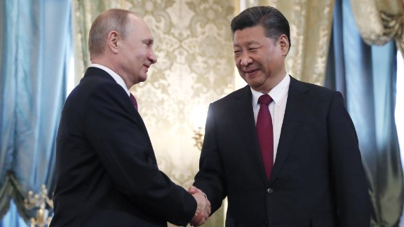 "Chinese President Xi Jinping (R) shakes hands with Russian President Vladimir Putin prior to a meeting on July 4, 2017 at the Kremlin in Moscow.  Russian President Vladimir Putin and Chinese leader Xi Jinping met July 4 against a backdrop of mounting tensions over North Korea ahead of G20 summit talks with US President Donald Trump. The talks were also expected to discuss North Korea after Pyongyang claimed the launch of its first inter-continental ballistic missile, and Trump urged China to ""end this nonsense once and for all"".  / AFP PHOTO / POOL / Sergei IlnitskySERGEI ILNITSKY/AFP/Getty Images"