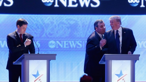 Christie visits with fellow presidential candidate Donald Trump during a commercial break of a Republican debate in February 2016. From the debate's outset, Christie pestered US Sen. Marco Rubio, left. His relentless attack against Rubio, who was surging in the polls, was one of the memorable takeaways of the night.