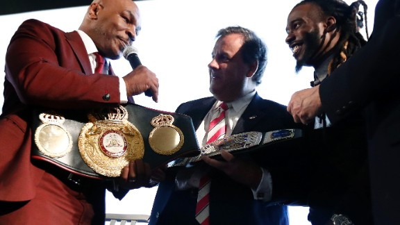 Boxing legend Mike Tyson presents Christie with a belt in April for the governor's work in helping former prisoners re-enter society.