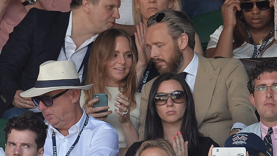 "McCartney, seen here with her husband Alasdhair Willis at the 2014 Wimbledon championships enjoys playing tennis too. ""I have a mean forehand, but a terrible, terrible backhand,"" she told CNN."