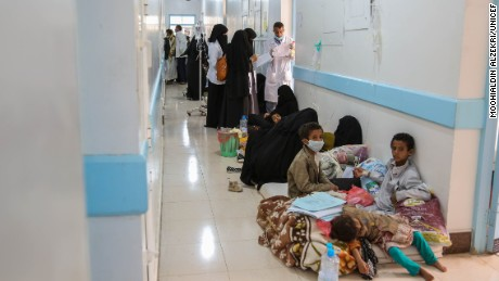 Cholera patients await treatment at a hospital in Sana'a, Yemen, in May.