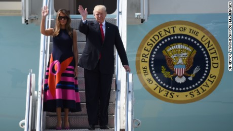 US President Donald Trump and US First Lady Melania Trump wave as they step off Air Force One upon arrival at the airport in Hamburg, northern Germany on July 6, 2017. (CHRISTOF STACHE/AFP/Getty Images)