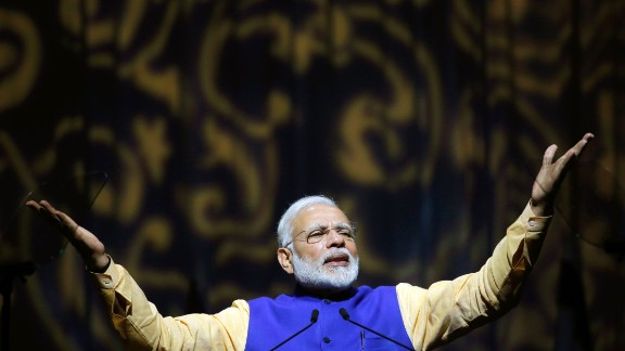 Indian Prime Minister Narendra Modi delivers a speech during a meeting with the Tel Aviv Indian community