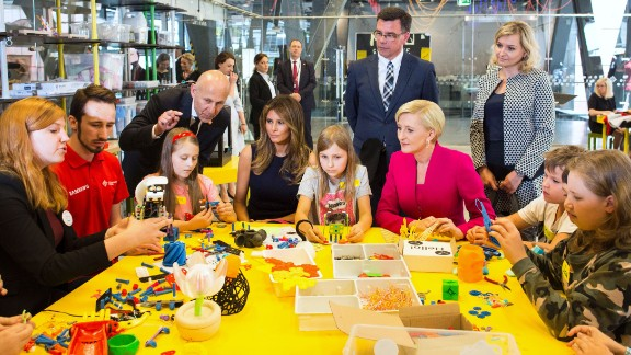 Trump, seated fourth from left, plays with children during a July visit to the Copernicus Science Centre in Warsaw, Poland. She was joined by Polish first lady Agata Kornhauser-Duda, who is in the pink jacket. The Trumps were visiting Poland ahead of a G20 summit in Germany.