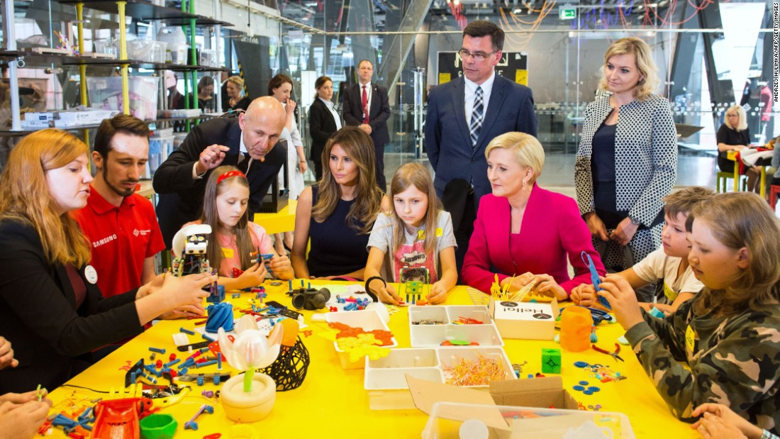 "Trump, seated fourth from left, plays with children during a July visit to the Copernicus Science Centre in Warsaw, Poland. She was joined by Polish first lady Agata Kornhauser-Duda, who is in the pink jacket. The Trumps <a href=""http://www.cnn.com/2017/07/06/politics/gallery/trump-poland-germany/index.html"" target=""_blank"">were visiting Poland</a> ahead of a G20 summit in Germany."