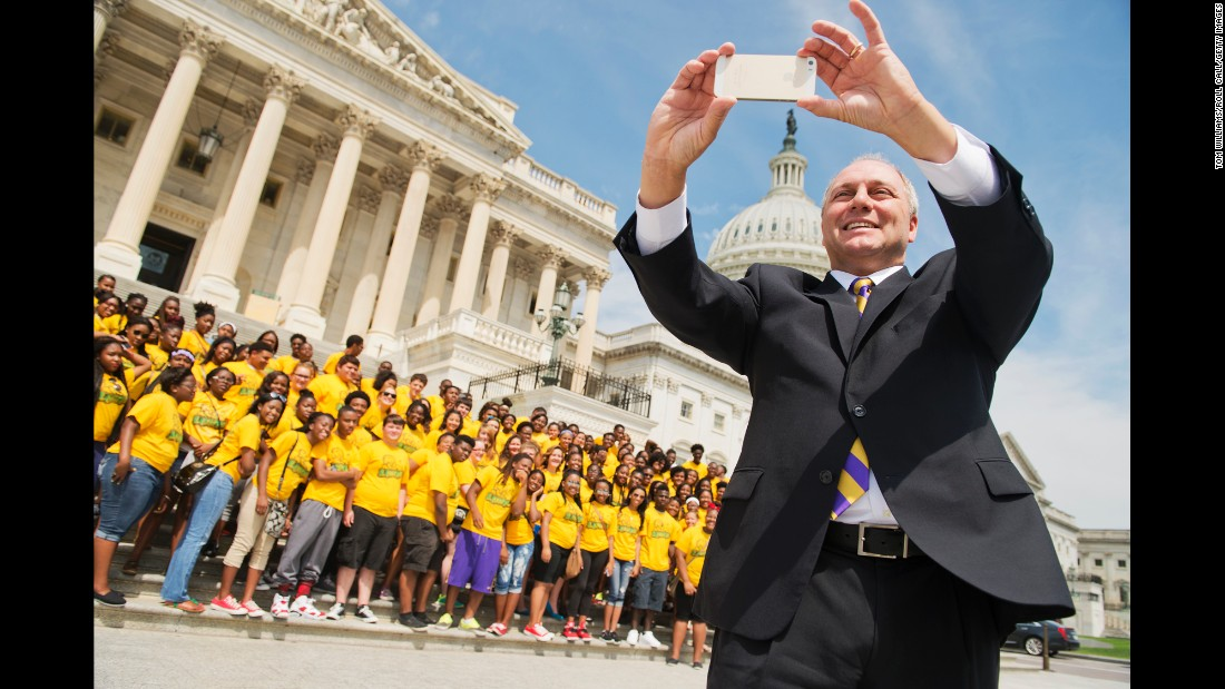 Scalise takes a selfie on the House steps in July 2014. Behind him are members of the Southeastern Louisiana Upward Bound program.