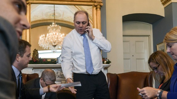 Scalise meets with staff members while checking a vote count in Washington in December 2014. As House majority whip, Scalise is tasked with tracking other Republican members and ensuring there are enough votes to win approval of key priorities.