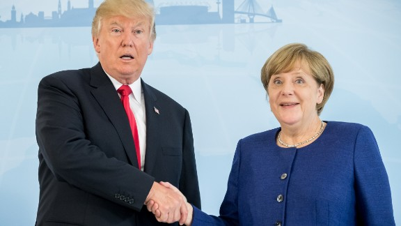 German Chancellor Angela Merkel and US President Donald Trump  shake hands prior to a bilateral meeting on the eve of the G20 summit in Hamburg, northern Germany, on July 6, 2017.