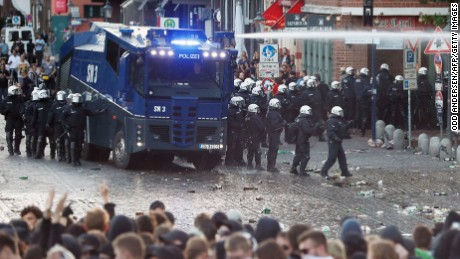 "Riot police use water cannon during the ""Welcome to Hell"" rally against the G20 summit in Hamburg, northern Germany on July 6, 2017."