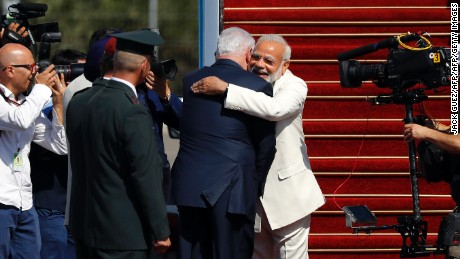Israeli Prime Minister Benjamin Netanyahu greets his Indian counterpart Narendra Modi at Ben-Gurion International airport near Tel Aviv on July 4, 2017.
