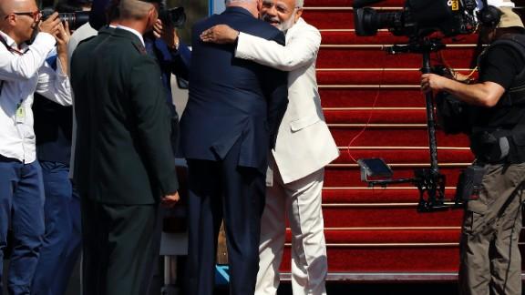 Israeli Prime Minister Benjamin Netanyahu greets his Indian counterpart Narendra Modi at Ben-Gurion International airport near Tel Aviv on July 4, 2017.