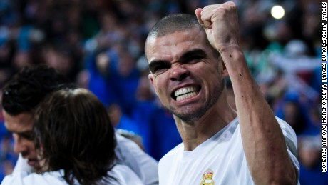 MADRID, SPAIN - APRIL 12:  Pepe (R) of Real Madrid CF celebrates his teammate Cristiano Ronaldo's (L) third goal during the UEFA Champions League quarter final second leg match between Real Madrid CF and VfL Wolfsburg at Estadio Santiago Bernabeu on April 12, 2016 in Madrid, Spain.  (Photo by Gonzalo Arroyo Moreno/Getty Images)