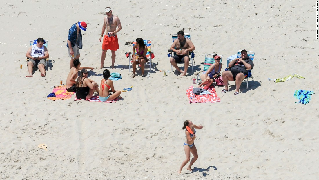 "New Jersey Gov. Chris Christie, right, spends time with family and friends at Island Beach State Park, where the governor has a summer residence, on Sunday, July 2. <a href=""http://www.cnn.com/2017/07/01/politics/nj-government-shutdown-chris-christie/index.html"" target=""_blank"">They were the only ones there</a> because two days earlier, Christie shut down the state government after the Legislature failed to pass a budget. All state-run tourist attractions were closed to the public."