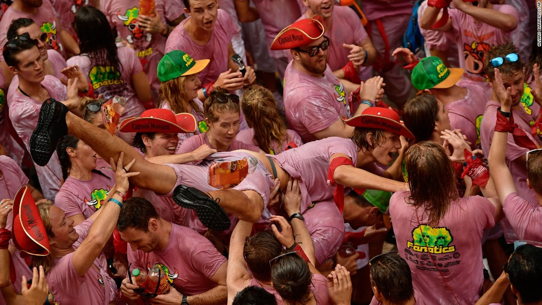 "Revelers party at the opening of the San Fermin festival in Pamplona, Spain, on Thursday, July 6. The festival is world-renowned for its <a href=""http://www.cnn.com/travel/article/spain-bull-running/index.html"" target=""_blank"">""running of the bulls.""</a>"