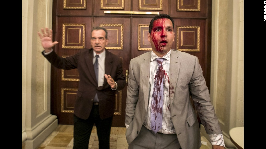 "Venezuelan lawmakers Luis Stefanelli, left, and Jose Regnault stand in a corridor of the National Assembly after <a href=""http://www.cnn.com/2017/07/05/americas/venezuela-indepedence-day-clashes/index.html"" target=""_blank"">a clash with demonstrators</a> in Caracas, Venezuela, on Wednesday, July 5. Supporters of embattled President Nicolas Maduro stormed the building and attacked opposition lawmakers, witnesses said. At least seven legislative employees and five lawmakers were injured, according to National Assembly President Julio Borges. Journalists said they were also assaulted."