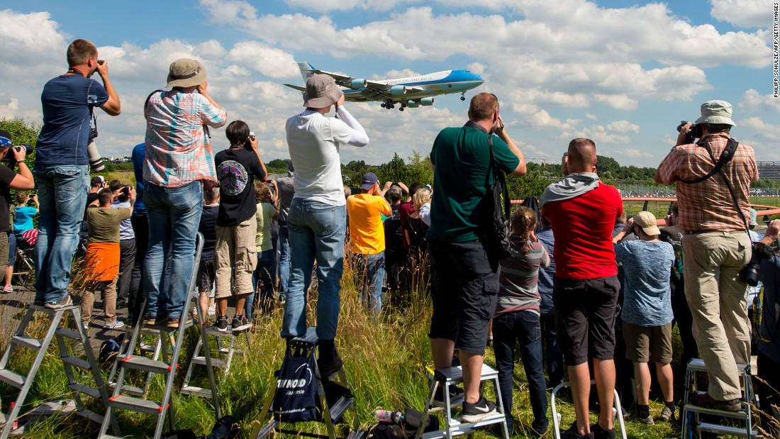"Aircraft enthusiasts photograph the landing of Air Force One in Hamburg, Germany, on Thursday, July 6. US President Donald Trump <a href=""http://www.cnn.com/2017/07/06/politics/gallery/trump-poland-germany/index.html"" target=""_blank"">was visiting</a> for the G20 summit."