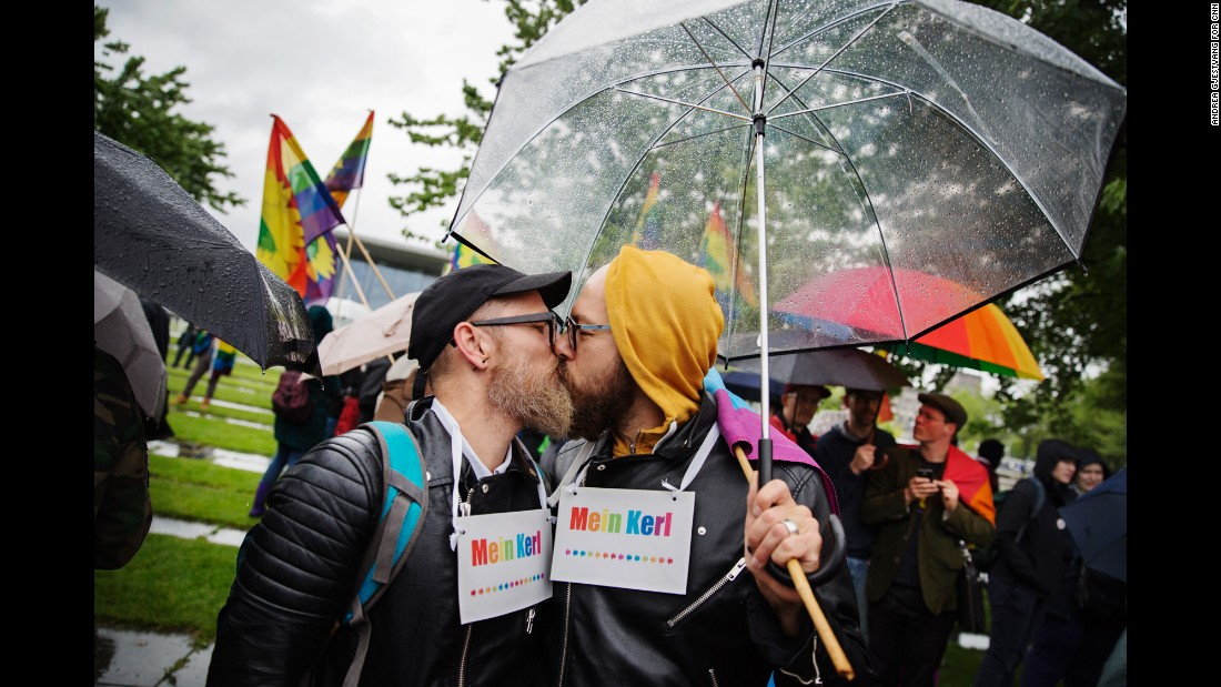 "Heiko Mersch, left, kisses Sebastian Oppermann outside the Chancellary in Berlin after German lawmakers <a href=""http://www.cnn.com/interactive/2017/06/world/germany-same-sex-marriage-cnnphotos/index.html"" target=""_blank"">voted to legalize same-sex marriage</a> on Friday, June 30."