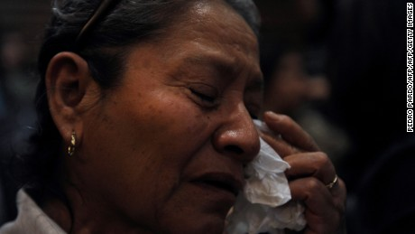 A woman cries during the presentation of the independent inquiry into the massacre of 72 migrants in San Fernando, Tamaulipas in August 2010 and the disappearance of residents of Allende, Coahuila, in 2011, at the Museum of Memory and Tolerance in Mexico City on October 9, 2016. / AFP / Pedro PARDO        (Photo credit should read PEDRO PARDO/AFP/Getty Images)