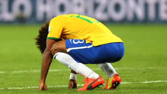 BELO HORIZONTE, BRAZIL - JULY 08:  A dejected Dante  of Brazil reacts after being defeated by Germany 7-1 during the 2014 FIFA World Cup Brazil Semi Final match between Brazil and Germany at Estadio Mineirao on July 8, 2014 in Belo Horizonte, Brazil.  (Photo by Martin Rose/Getty Images)